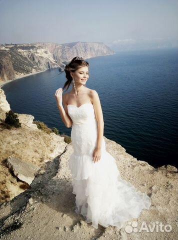 bd50e468f3f Свадебное платье со шлейфом и воланами купить в Санкт-Петербурге на ...